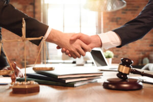 Lawyer and his client handshake after a successful tax case in Phoenix.